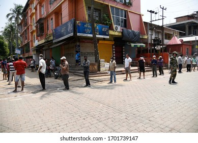 Guwahati, Assam, India. 12 April 2020.  People are in que to buy chicken, during the nationwide lockdown to curb the spread of coronavirus, in Guwahati.