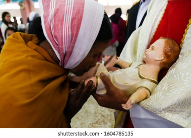 Guwahati, Assam, India. 25 December 2019. An Indian devotee kisses a doll depicting the infant Jesus after Christmas prayers at St John's Church in Guwahati.