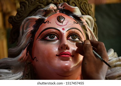 Guwahati, Assam, India. 27 September 2019.  Artist gives the final touches to an idol of the Goddess Durga ahead of Durga Puja festival, in Guwahati.