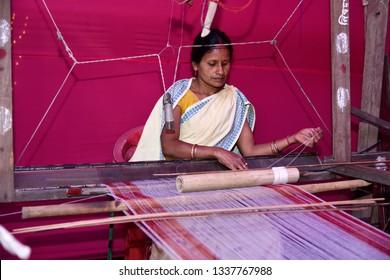 Guwahati, Assam, india. 8 March 2019. Women weaving Assamese Traditional gamosa agead of Rongali Bihu in Assam.