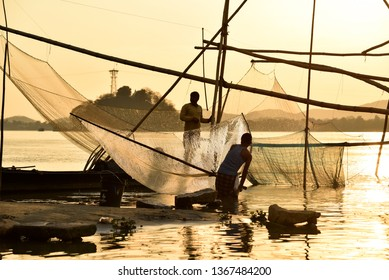 Guwahati, Assam, India. April 10, 2019. Fisherman fishing in the Brahmaputra river at sunset in Guwahati.