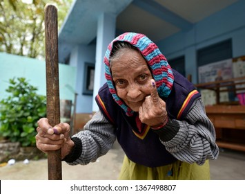 Guwahati, Assam, India. April 11, 2019. A woman shows her ink-marked finger after casting her vote at a polling station in Shillong.