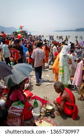 GUWAHATI, ASSAM, INDIA – APRIL 17, 2005 : Devotees offer and praying for traditional Assamese New Year on the banks of Brahmaputra River.
