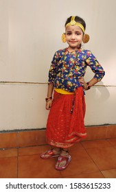 """ Guwahati, Assam / India - December 07, 2019 : A cute little girl in traditional Nepali dress. """