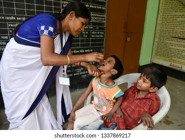 Guwahati, Assam, India. March 10, 2019. An Indian child receives polio vaccine drops on National Immunisation Day in Guwahati.
