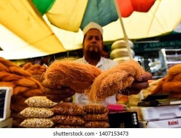Guwahati, Assam, India. May 21, 2019. Muslim vendor selling vermicelli and other dry fruits at a market stall as Ramadan, fasting period of Muslims is going on and dry fruits are on demand.