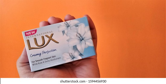 Guwahati, Assam/India-21 December 2019: New international lux soap with creamy perfection is being shown isolated on orange background