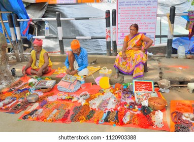 Guwahati, India - June 23, 2018: Street vendors selling artificial jewelry by the roadside on the eve of Ambubachi mela.