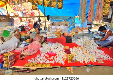 Guwahati, India - June 23, 2018: Street vendors selling conch shell in the market.