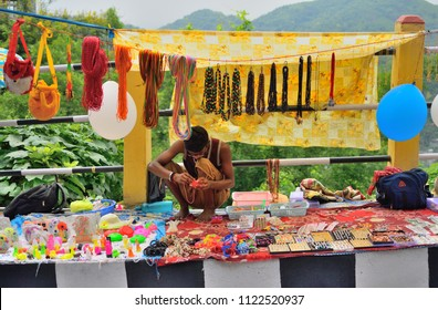 Guwahati, India - June 23, 2018: Street vendors selling variety of items by the roadside.