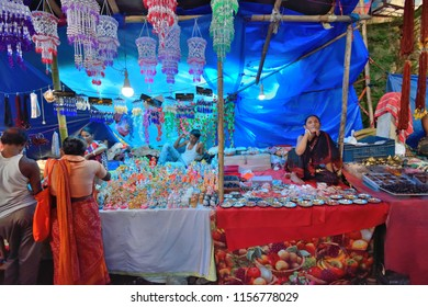 Guwahati, India - June 23, 2018: Street vendors selling artificial jewelry and idols on the eve of Ambubachi mela.