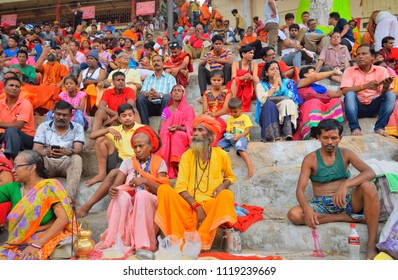 Guwahati, India - June 24, 2018: A huge crowd of devotees sitting on the stairs during Ambubachi mela.