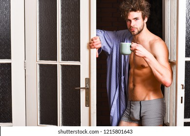 Guy attractive lover enjoy morning coffee. Sexy macho tousled hair coming out bedroom door. Seductive lover full of desire. Man lover near door. Sexy bachelor lover concept. That was great night.