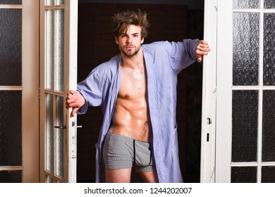 Guy attractive lover posing seductive. Sexy macho tousled hair coming out bedroom door. Seductive lover full of desire. Man lover near door. Sexy bachelor lover concept. That was great night.