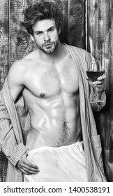 Guy attractive relaxing with alcohol drink. Man sexy chest sweaty skin hold wineglass. Macho tousled hair degustate luxury wine. Drink wine and relax. Bachelor enjoy wine. Erotic and desire concept.