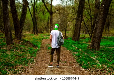 guy with backpack in the woods