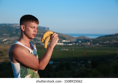 Guy. banana, Man. fruit, Nature, food, summer, Relax, Model, resort, food, Male. Sexy, sexually, resort. tasty, Health. Body, lifestyle, fitness model, Muscular, power