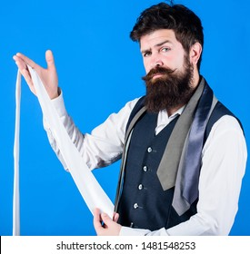 Guy with beard choosing necktie. Perfect white silk necktie. How to select tie. When dressing in suit necktie often add dash of flavor to overall outfit. Man bearded hipster hold few neckties.