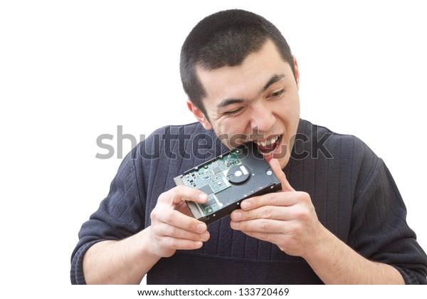 Guy bites hard drive