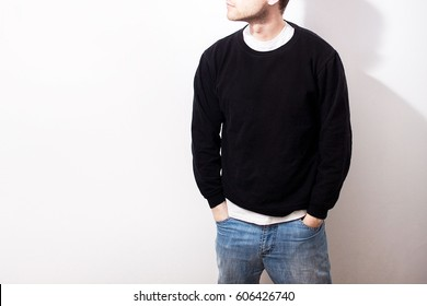 the guy in the Blank black hoodie, sweatshirt, stand, on a white background, mock up, free space, logo, template for print,  design