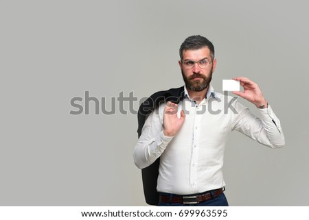 Guy blank business card copy space stock photo edit now 699963595 guy with blank business card copy space businessman with tricky face and glasses isolated colourmoves