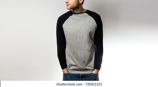 the guy in the blank grey black, sweatshirt, stand,  smiling on a white background, mock up, free space, logo, design, template for design print