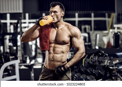 guy bodybuilder in gym and drink sportive nutrition - protein of shaker , horizontal photo