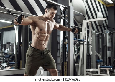 guy bodybuilder, perform exercise with exercise machine on pectoral muscles, in gym