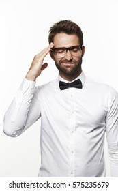 Guy in bow tie and shirt thinking hard