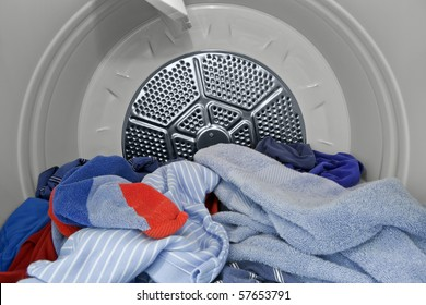 Guy clothes and towels in the dryer.   Fresh, clean and ready to fold.