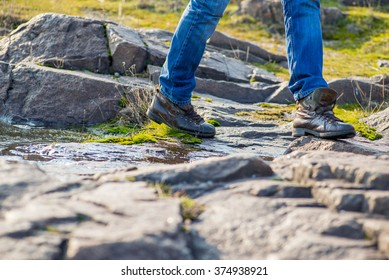 guy in comfortable shoes stepping on stones