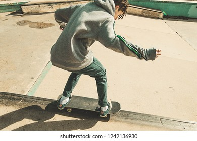 Guy doing skateboarding tricks at the skatepark. Urban sports concept