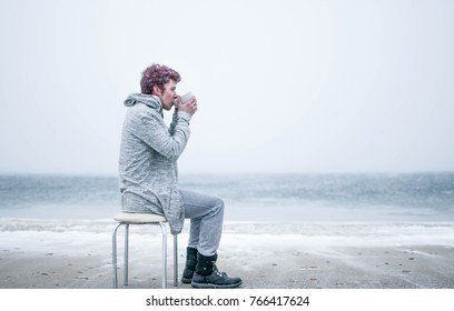 guy drinking coffee in winter
