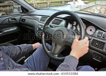 Guy driving a Mitsubishi