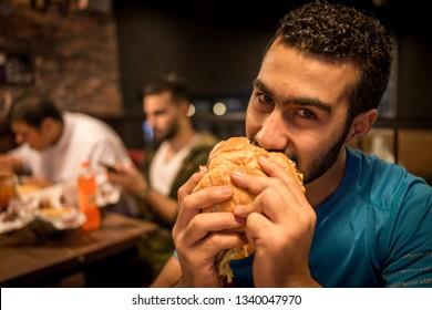 Guy eating burger