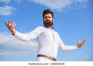 Guy enjoy top achievement. Superiority and power. Man bearded hipster formal clothes feels proud of himself sky background. Self proud feeling. Hipster beard and mustache looks attractive white shirt.