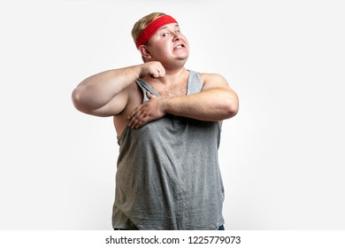 Guy expressing tiredness of gis effort to loose weight. Portrait of upset funny plump man, holding hands on neck while choking, looking up, committing suicide over grey wall