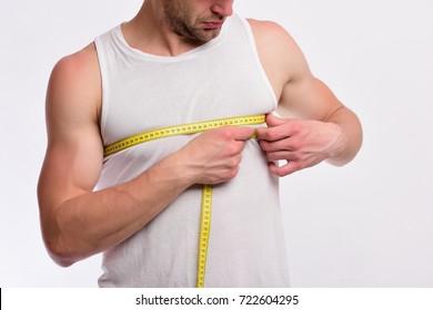 Cute guy measuring ruler