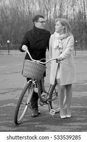 Guy and girl with a bike