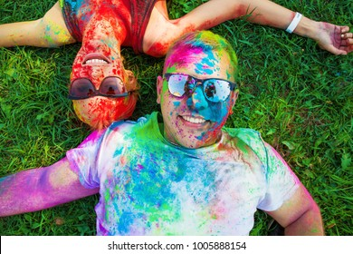 Guy with a girl celebrate holi festival, make selfie