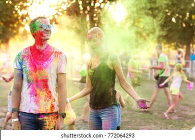 Guy with a girl celebrate holi festival