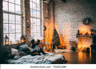 A guy with a girl is celebrating Christmas. A loving couple enjoy each other on New Year's Eve. New Year's love story