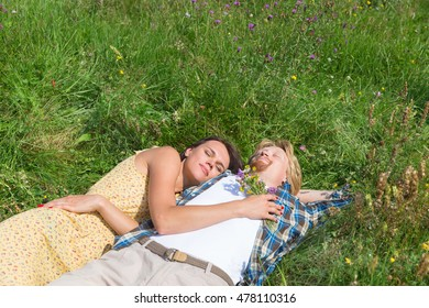 The guy and the girl are in the field