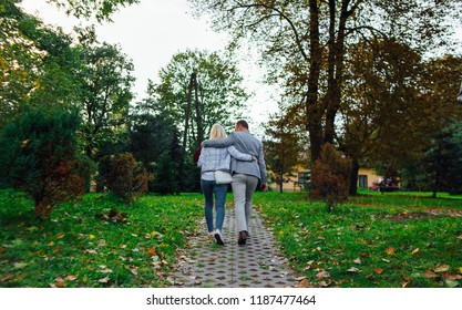 guy with a girl go into the distance
