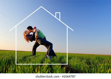 The guy and the girl kiss in a autumn field and dreams about the new house