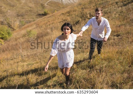 Girl running away from guy