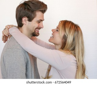 guy and girl smiling and hugging