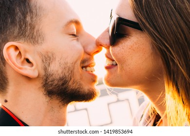 guy and girl want to kiss. bearded guy and girl with freckles in sunglasses