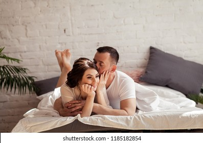 guy and girl in white bed