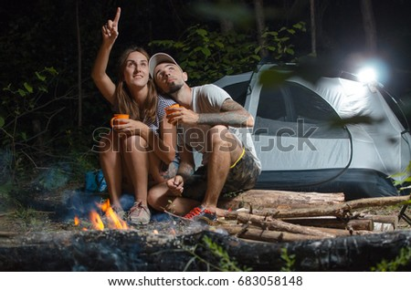 guy girl woods tent night sitting stock photo edit now 683058148